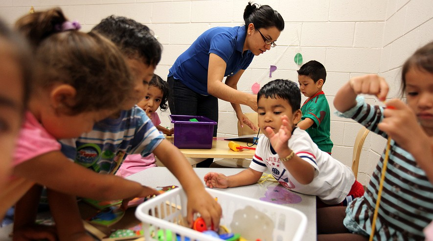 Teacher Gines Gaytan works with children at the River Valley Migrant and Season Head Start program for the children of migrant and seasonal workers in Kankakee, Illinois, on July 16, 2010.