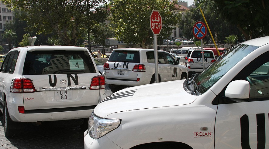 A U.N. team, that is scheduled to investigate an alleged chemical attack that killed hundreds last week in a Damascus suburb, leaves their hotel in a convoy Aug. 26, 2013. An AP photographer saw the U.N. members, wearing body armor, leaving in seven SUVs.
