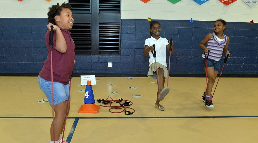 Fourth-graders (from left) Makenzie Thompson, Reagan Lloyd and Jayda Smith use exercise bands in a program after school at Stonewall Tell Elementary School, Sept. 9, 2013, in College Park, Ga. Stonewall's exercise program is not new, but it just won a gold award from the state for its efforts to get kids moving and be healthy.
