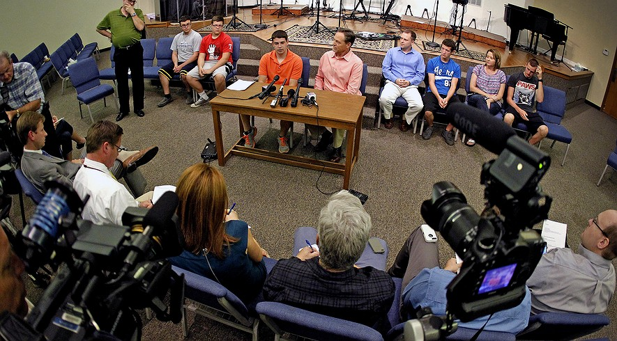 Evan Jennings (center) speaks to the media about his father, Brian Jennings, as he sits with friends and senior pastor Scott Sharman. Brian Jennings was one of four people killed in a drunk driving crash in June. The teen driving the car got probation instead of prison.