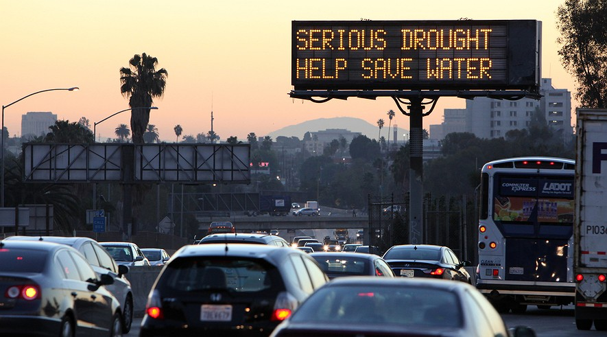 Morning traffic makes its way toward downtown Los Angeles along the Hollywood Freeway past an electronic sign warning of severe drought on Feb. 14, 2014. California is taking to the highways to spread the word about water conservation after months of drought.