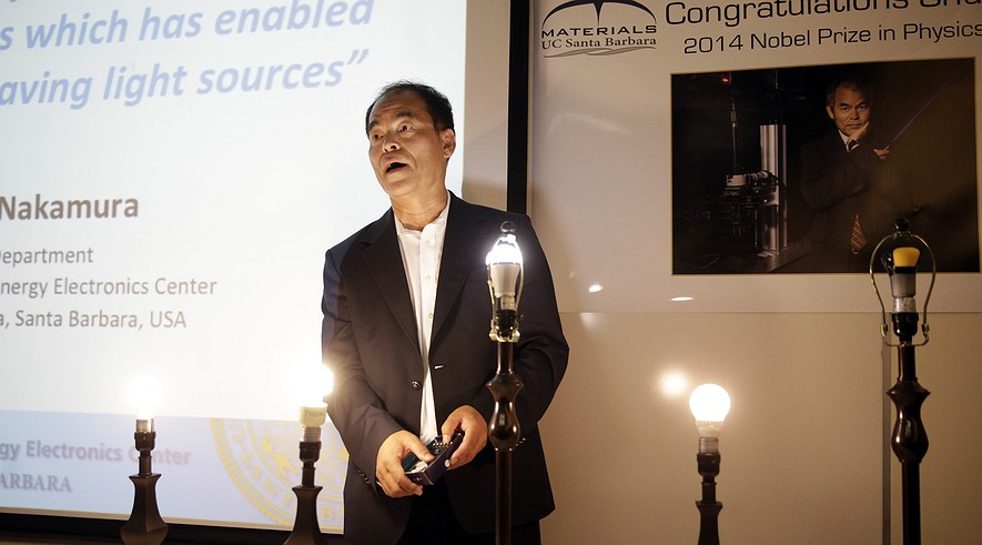 Scientist Shuji Nakamura, a Japanese-born American professor at the University of California, Santa Barbara, demonstrates LED lights during a news conference, Tuesday, Oct. 7, 2014, in Santa Barbara, California.