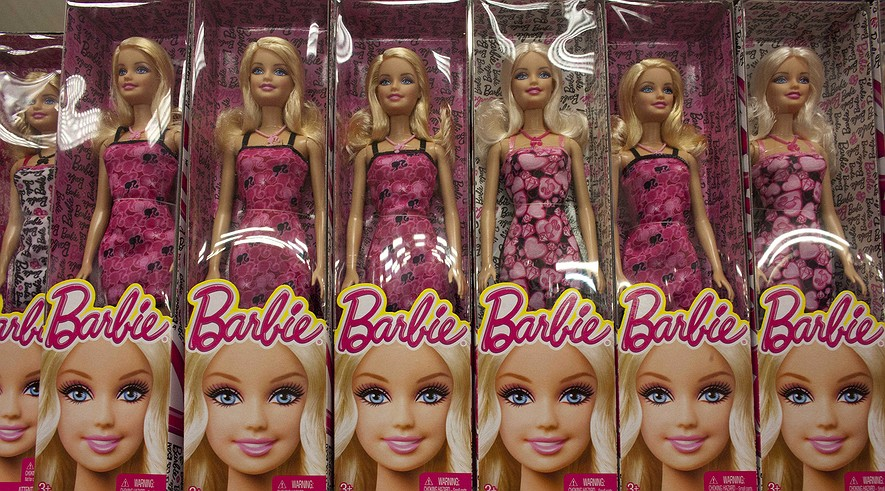 A selection of Barbie dolls fill a shelf at a store in Caracas, Venezuela, Nov. 10, 2014.