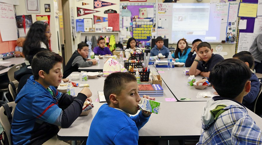 Students are served breakfast at the Stanley Mosk Elementary School in Los Angeles, California, April 8, 2015.