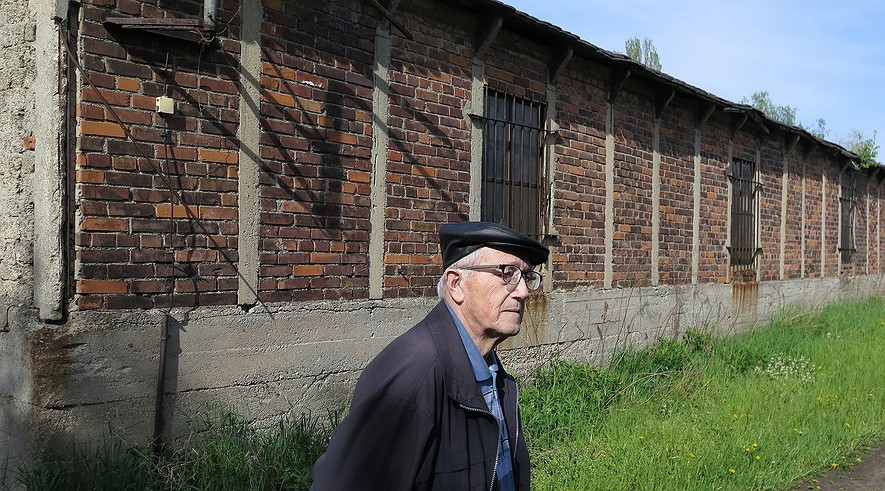 Lothar Czossek, 86, in Remsdorf just outside of Troeglitz, Germany, said that being home to a branch of the Buchenwald concentration camp should have taught area residents the importance of the needs of others. Here he is standing near the old camp barracks on April 29, 2015.