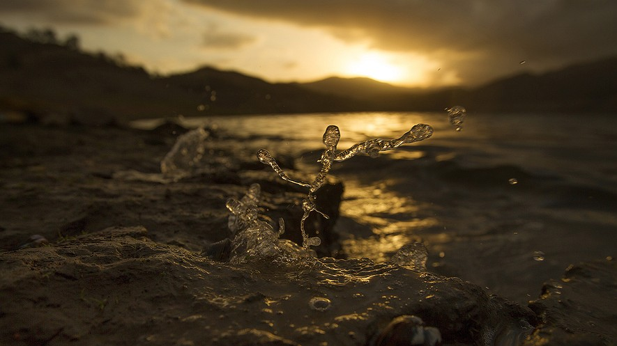 "At sunrise, wind pushes the receding water to splash up on the banks at Pine Flat Reservoir in Sanger, California. As a fourth year of drought continues in the state, water experts are suggesting a water recycling policy called ""direct potable reuse"" — taking treated sewage and purifying so it can be used as drinking water."
