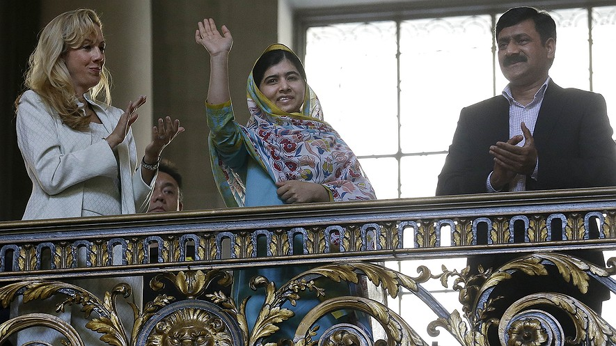 Nobel Peace Prize recipient Malala Yousafzai (center) waves while being introduced at a ceremony for the 70th anniversary of the United Nations in San Francisco, California, June 26, 2015.
