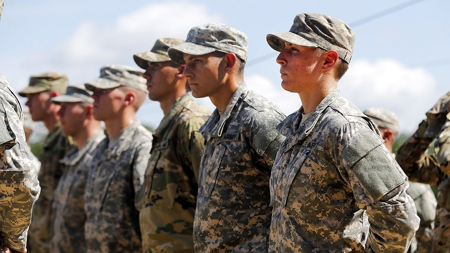 U.S. Army First Lieutenant Shaye Haver (right) stands in formation during the Army Ranger School graduation ceremony on Aug. 21, 2015, at Fort Benning, Georgia. Haver and Captain Kristen Griest became the first female soldiers to complete the Army's rigorous school.