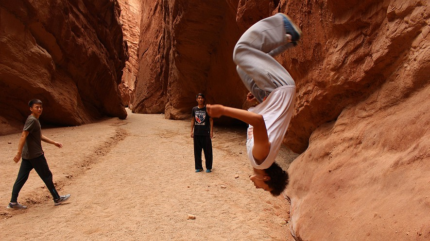 Ali, a member of the Aksu parkour club, performs a flip at Wensu Grand Canyon Park on July 28, 2015. Parkour is a form of urban acrobatics, involving jumps, flips and vaults off of various structures. The Urumqi club now has some 25 members, including Uighurs and Han Chinese in a part of China - Xinjiang - where the two ethnic groups have long clashed.