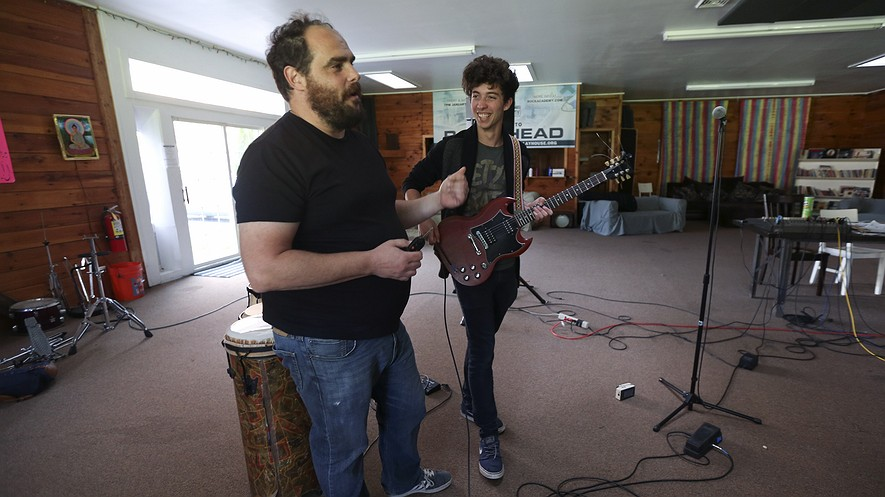 Paul Green( left) talks with student Diggy Lessard at the Paul Green Rock Academy in Saugerties, New York. Green and Michael Lang have co-founded the Woodstock Music Lab, a rock school for college-age students, with hopes of opening the school in 2016.