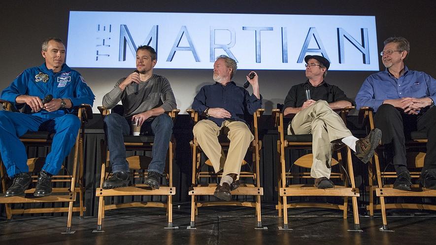 "In this photo released by NASA, (from left) astronaut Drew Feustel, actor Matt Damon, director Ridley Scott, author Andy Weir and Jim Green, director of the Planetary Science Division at NASA, participate in a question and answer session about NASA's journey to Mars and the film ""The Martian"" at the United Artists Theater in La Canada Flintridge, California, Aug. 18, 2015."