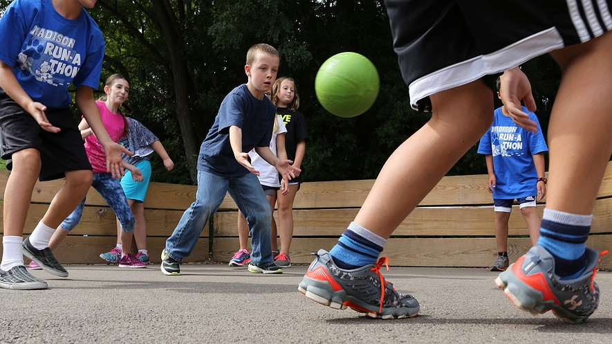 """Madison Elementary School fifth-graders including Matthew Hyde (center) play a game of gaga ball during recess, Wheaton, Illinois, Sept. 24, 2015. The game is called a """"kinder, gentler"""" version of dodgeball."""