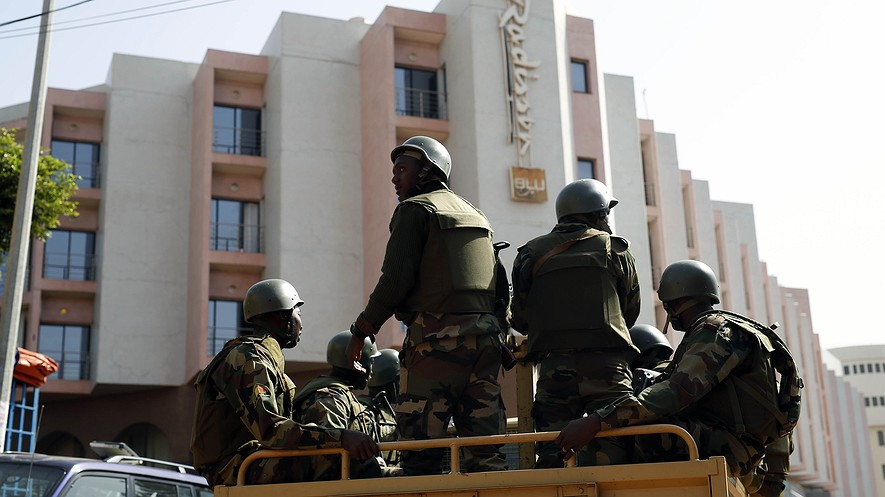 Soldiers on patrol outside the Radisson Blu hotel in Bamako, Mali, Nov. 21, 2015.
