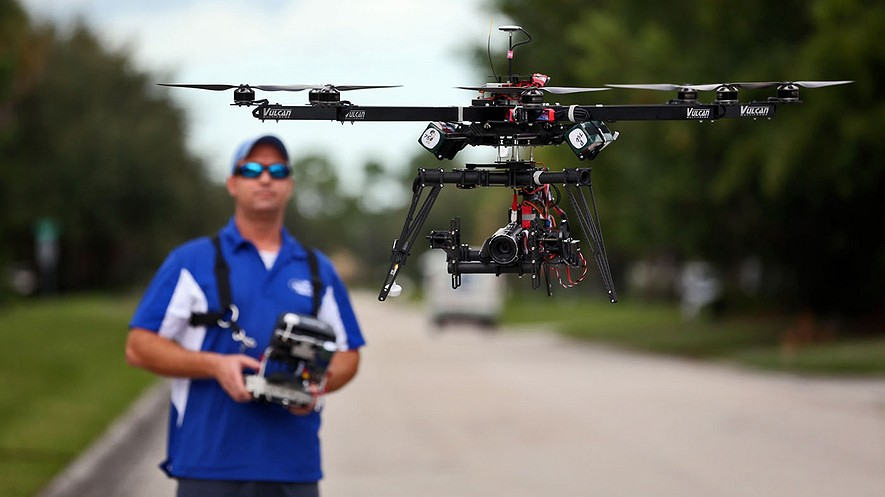 ReadyHeli.com technician and sales agent Brett Strand operates his own personal octacopter drone in Jupiter, Florida, Dec. 4, 2013.