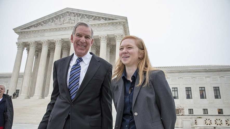 Abigail Fisher (right), who challenged the use of race in college admissions, walks with her lawyer, Bert Rein, outside the Supreme Court in Washington, D.C., Dec. 9, 2015, following oral arguments in the Supreme Court in a case that could cut back or even eliminate affirmative action in higher education.