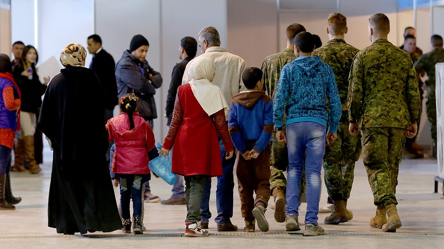 Syrian refugees wait at Marka Airport in Amman, Jordan, on Dec. 8, 2015, to complete their migration procedures to Canada, which has announced that it will take around 25,000 Syrians from Jordan, Lebanon and Turkey.