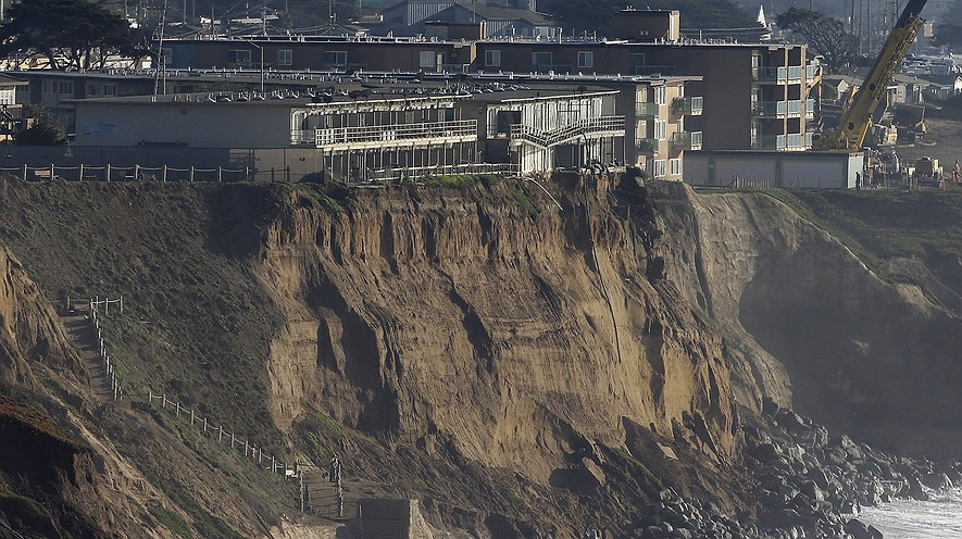 Boulders shore up an eroding cliff below an apartment complex that residents were recently forced to evacuate in Pacifica, California. Living with the Pacific Ocean as your back yard has its benefits, but the crumbling ocean cliffs have forced dozens to move out quickly and at a high cost.