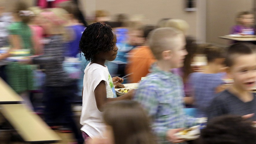 Watford City Elementary School students dine in the cafeteria in Watford City, North Dakota, Dec. 17, 2014. More Americans agree today than in the past that racism and unfair treatment is a problem.