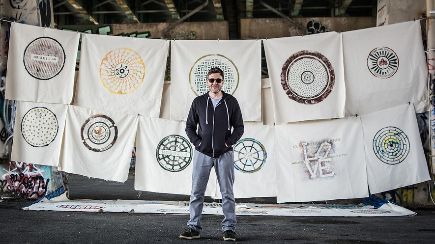 Russell Muits, a graphic designer who has created a series of prints depicting various manhole covers across the United States, displays his work at the FDR Skatepark in South Philadelphia, Pennsylvania, March 17, 2016.