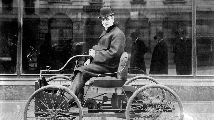 Henry Ford sits in his first automobile, the Ford Quadricycle, in 1896. Also called a horseless carriage, it sold for $200.