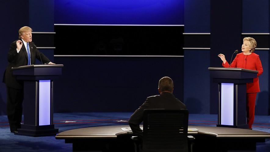 Republican presidential nominee Donald Trump (left) and Democratic presidential nominee Hillary Clinton spar during the presidential debate at Hofstra University in Hempstead, New York, Sept. 26, 2016.