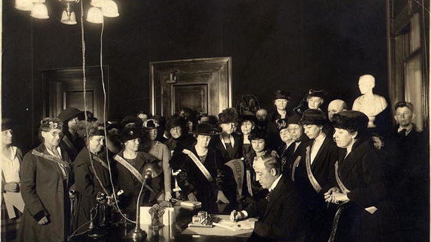 Surrounded by members of the Kentucky Equal Rights Association, Kentucky Governor Edwin P. Morrow signs the bill ratifying the 19th Amendment on January 6, 1920, giving women the right to vote.