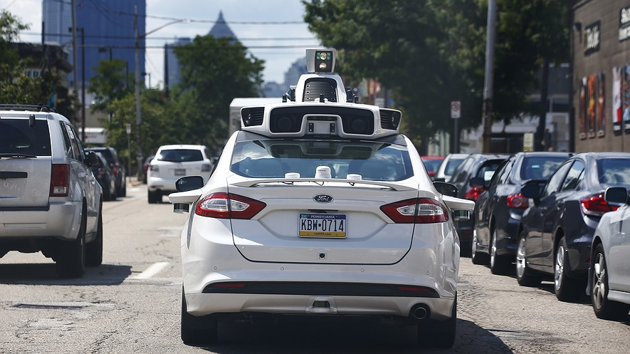A self-driving Ford Fusion hybrid car is test driven in Pittsburgh, Pennsylvania, on August 18, 2016.