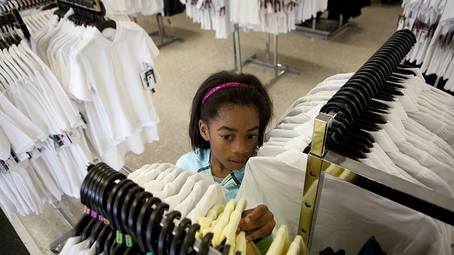 Phoenix Anderson, 6, of Chicago, shops for school uniforms at Kmart. Kmart has expanded online and in-store uniform offerings in response to the growing number of public schools that require students to wear uniforms.