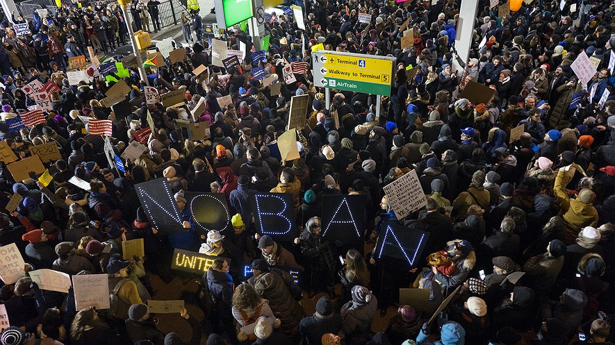 Protesters assemble at John F. Kennedy International Airport in New York, January 28, 2017, after earlier in the day two Iraqi refugees were detained while trying to enter the country. On January 27, President Donald Trump signed an executive order banning all refugees and immigrants from seven Muslim-majority countries for the next 90 days. AP Photo/Craig Ruttle