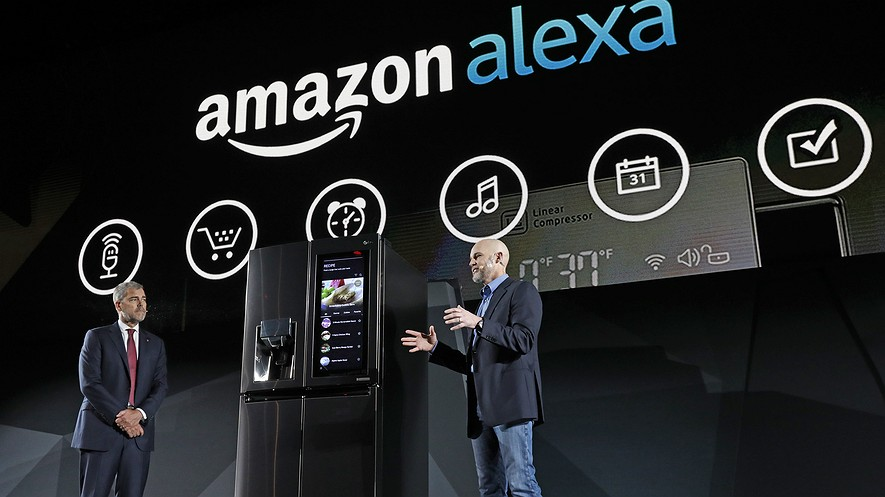 LG Electronics Vice President David VanderWaal and Amazon Echo Vice President Mike George present the LG Smart InstaView Door-in-Door Refrigerator to CES 2017 attendees at the LG Electronics press conference on January 4, 2017, in Las Vegas, Nevada.