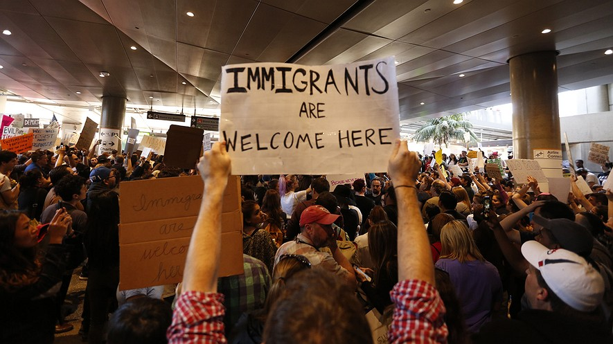 Hundreds of people protest President Donald Trump's travel ban on January 29, 2017, at the Tom Bradley International Terminal at Los Angeles International Airport in California. Photo: Genaro Molina/Los Angeles Times/TNS