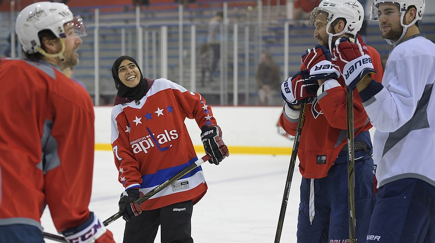 United Arab Emirates women's hockey player Fatima Al Ali (second from left) talks to (from left) Justin Williams, Alex Ovechkin and Tom Wilson of the Washington Capitals. Photo by: John McDonnell, Washington Post