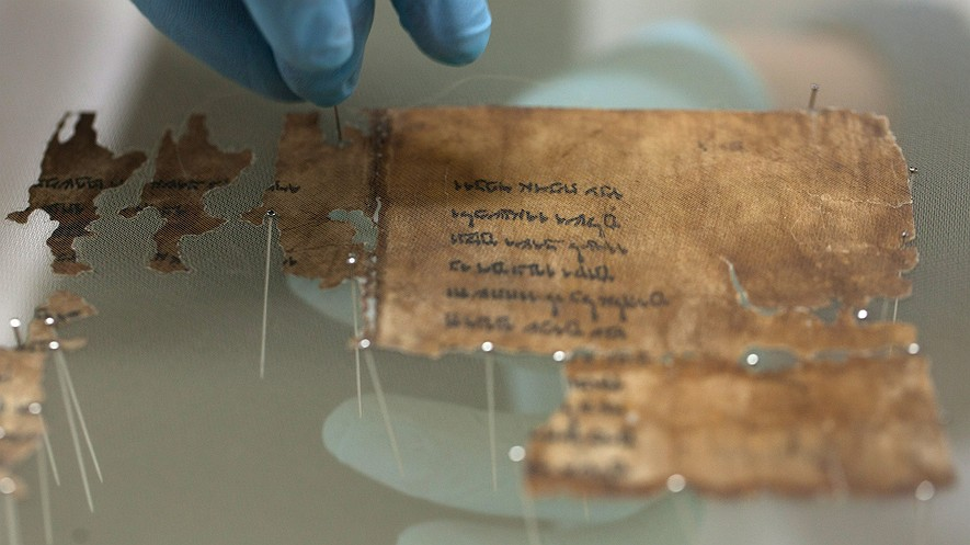 A conservation analyst with the Israel Antiquities Authority prepares fragments of the 2,000-year-old Dead Sea Scrolls at a laboratory before photographing them on December 18, 2012, in Jerusalem, Israel. Photo by: Uriel Sinai/Getty Images