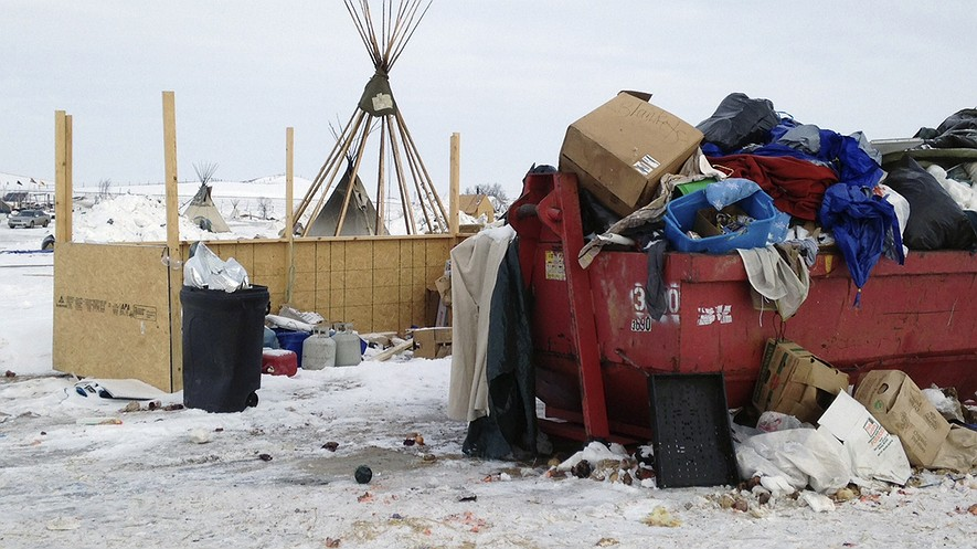 Trash is piled in a dumpster at an encampment set up near Cannon Ball, North Dakota, February 8, 2017, for opponents against the construction of the Dakota Access pipeline. Photo by: AP Photo/James MacPherson