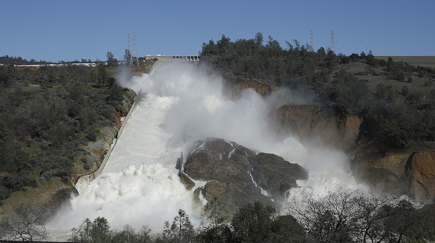 Water flows down Oroville Dam's main spillway near Oroville, Northern California. Officials have ordered residents near the dam to evacuate the area.