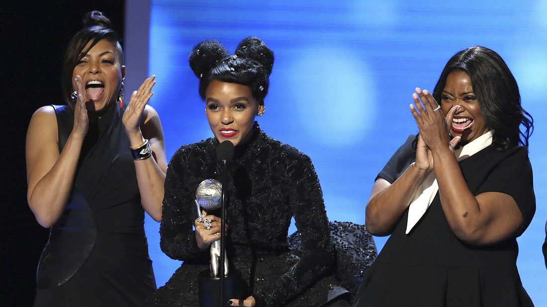"""(From left) Taraji P. Henson,Janelle Monae and Octavia Spencer accept the award for outstanding motion picture for """"Hidden Figures"""" at the 48th annual NAACP Image Awards at the Pasadena Civic Auditorium in Pasadena, California, February 11, 2017\. Photo by: Matt Sayles/Invision/AP."""