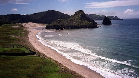 Awana Beach, on the east coast of the Great Barrier Island, lies in the outer Hauraki Gulf of New Zealand. Photo: Ross Land/Getty Images.