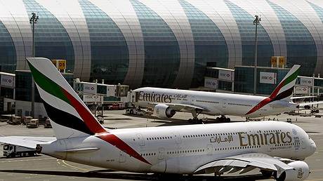 Emirates planes wait to take off at Dubai airport in United Arab Emirates. The U.S. government is temporarily barring passengers on certain flights originating in eight other countries from bringing most types of electronics in their carry-on luggage. A U.S. official told the Associated Press that the ban beginning March 21, 2017, affects airports in 10 cities: Cairo in Egypt; Amman in Jordan; Kuwait City in Kuwait; Casablanca in Morocco; Doha in Qatar; Riyadh and Jeddah in Saudi Arabia; Istanbul in Turkey; and Abu Dhabi and Dubai in United Arab Emirates. Photo by: AP Photo/Kamran Jebreili