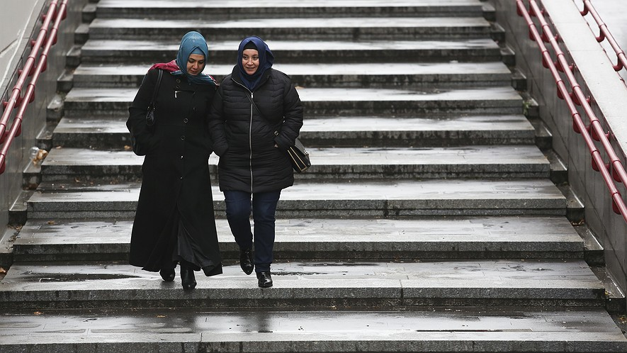 Two women wearing headscarves are walking in Vienna, Austria, December 1, 2016. Photo by: Alex Domanski/Getty Images