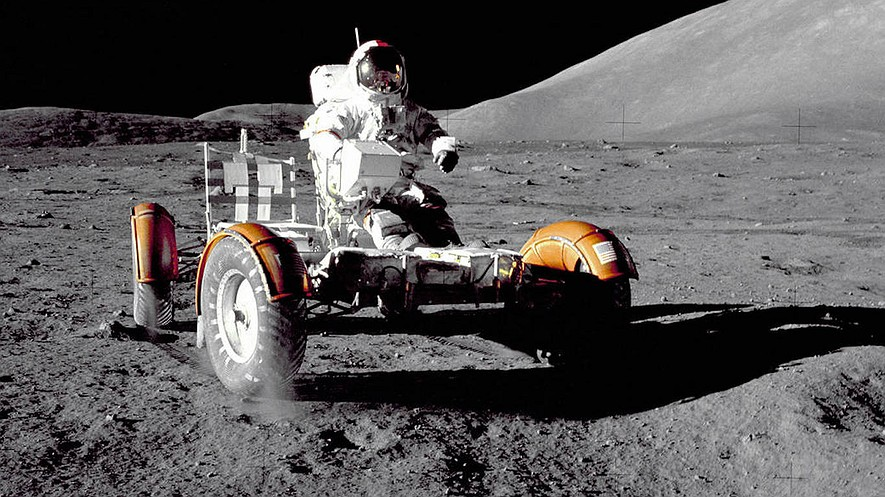 Apollo 17 mission commander Eugene A. Cernan makes a short checkout of the Lunar Roving Vehicle during the early part of the first Apollo 17 extravehicular activity at the Taurus-Littrow landing site. This view of the lunar rover prior to loadup was taken by Harrison H. Schmitt, Lunar Module pilot. Photo: NASA