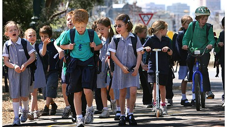 Albert Park Primary School students in their uniforms walk, ride and scoot to school. Photo by Fairfax Media/Fairfax Media via Getty Images