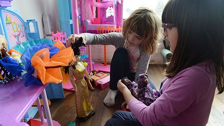Lucy Michaels (left), of Edgewood, Pennsylvania, and Grace Fetterman play with dolls, including two with the Hello Hijab, at Grace's home in Braddock, Pennsylvania. Photo by: Rebecca Droke/Pittsburgh Post-Gazette/TNS