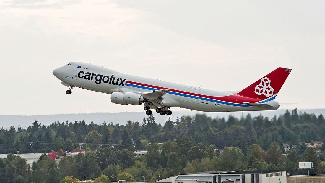 A 747-8 freighter takes off from Seattle-Tacoma International Airport in Washingto state, heading to Luxembourg on its first revenue flight. Photo by: Jim Anderson/Boeing