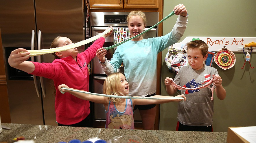 (From left) Caitlyn Garofoli and Zoe Martin, both 13, Caitlyn's little sister Keira, 6, and their brother Ryan, 10, after making slime for their business, Chicago Slime, on March 7, 2017, at Caitlyn's home in Chicago, Illinois. Photo : Nuccio DiNuzzo/Chicago Tribune/TNS