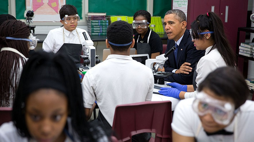 Former President Barack Obama met students working in a biomedical sciences classroom at Bladensburg High School in Bladensburg, Maryland, April 7, 2014. Now, state lawmakers plan to implement Obama's Every Student Succeeds Act. Photo by: Pete Souza/White House