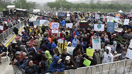 With the White House in the background, participants gather for the March for Science in Washington, D.C., on April 22, 2017. Thousands of scientists worldwide left their labs to take to the streets along with students and research advocates in pushing back against what they say are mounting attacks on science. Photo by: AP Photo/Sait Serkan Gurbuz