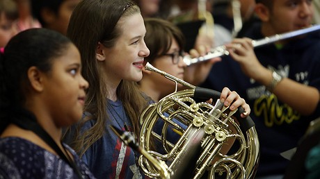 Students received a $35,000 donation of musical instruments at Ron Russell Middle School on September 17, 2015, in Portland, Oregon. Photo by: Jackie Butler/Getty Images for StubHub