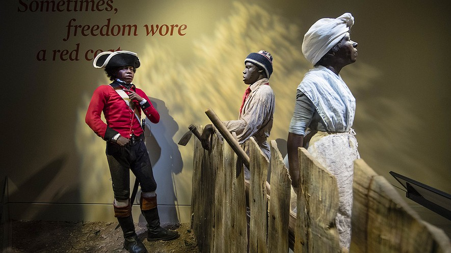 This April 13, 2017, photo depicts 14-year-old London Pleasants (left) who left slavery by joining a Loyalist regiment encouraging other slaves to flee to the British Army in search of freedom, at the Museum of the American Revolution in Philadelphia, Pennsylvania. AP Photo/Matt Rourke