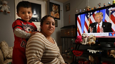 Abigail Alvarado, 26, and her son, Antonio, 2, watch President Donald Trump on TV on January 11, 2017, at their home in the Little Village neighborhood of Chicago, Illinois. Alvarado, who is an unauthorized immigrant, is nervous about a possible Trump immigration crackdown. Photo: Antonio Perez/Chicago Tribune/TNS
