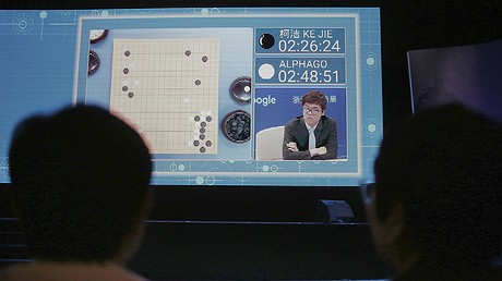 Spectators watch a video screen as go player Ke Jie plays a match against Google's artificial intelligence program AlphaGo during the Future of Go Summit in Wuzhen, China, May 23, 2017. Ke Jie, the world's top-ranked go player, started a three-round showdown against AlphaGo, which beat a South Korean go master in a five-round showdown last year. Photo by: AP Photo/Peng Peng